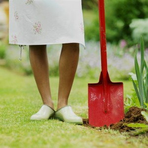 Close-up low section of woman holding spade